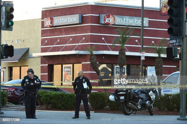 Police officers are posted outside a Jack in the Box restaurant in Hollywood California January 31 after police shot and killed a knifewielding...