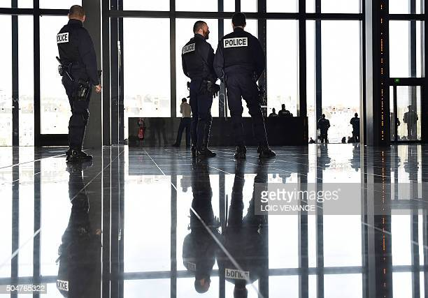 Police officers are seen ahead of a hearing of families threatened of expulsion from the NotreDamedesLandes area where the future Nantes airport is...