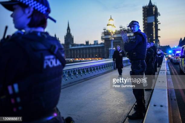 Police officers are seen applauding NHS staff and key workers on Westminster Bridge on April 09, 2020 in London, England. Following the success of...