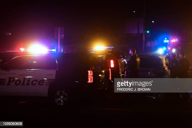 TOPSHOT Police officers are seen at the intersection of US 101 freeway and the Moorpark Rad exit as police vehicles close off the area responding to...