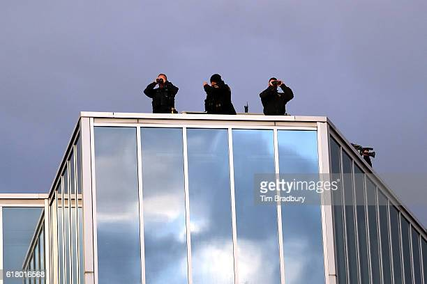 Police officers are seen atop a roof prior to Game One of the 2016 World Series between the Chicago Cubs and the Cleveland Indians at Progressive...