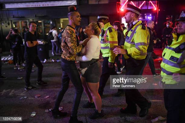 Police officers are seen breaking up a fight outside a pub in Soho on July 4, 2020 in London, United Kingdom. The UK Government announced that Pubs,...