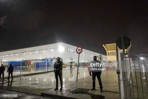 Police officers are seen controlling the access of the warehouse during the strike The workers of the largest Amazon warehouse in Spain strike on...