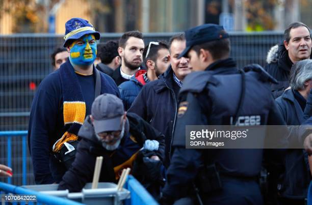 Police officers are seen controlling the security architecture of the Estadio Santiago Bernabeu before the second football match between River Plate...