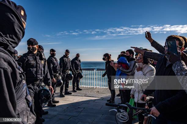Police officers are seen in Barceloneta to prevent the anti-fascist protesters approaching the information tent of the far-right party VOX....