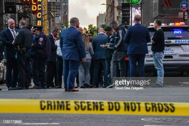 Police officers are seen in Times Square on May 8, 2021 in New York City. According to reports, three people, including a toddler, were injured in a...