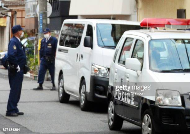 Police officers are seen near the apartment building where Mayumi Saito lives is seen on November 20 2017 in Neyagawa Osaka Japan She was arrested...