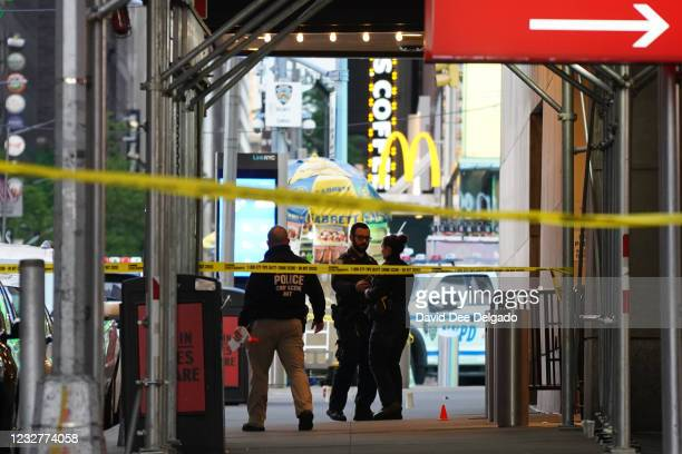 Police officers are seen next to marked shell casings from a gun in Times Square on May 8, 2021 in New York City. According to reports, three people,...