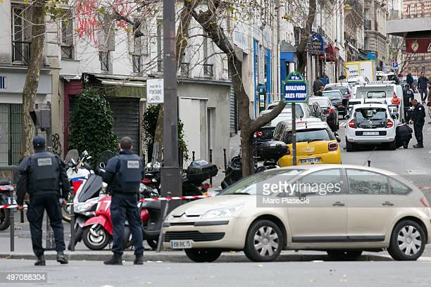 Police officers are seen on 'Boulevard Jules Ferry' after a terrorist attack on November 14 2015 in Paris France At least 120 people have been killed...