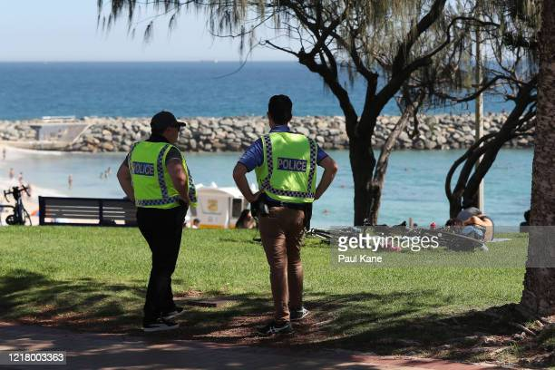 Police officers are seen patrolling Cottesloe Beach on April 10, 2020 in Perth, Australia. Australians have been urged to avoid all unnecessary...