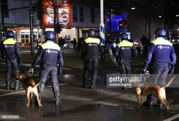 Police officers are seen seen with police dogs as they disperse Turkish citizens gathering outside Turkish consulate in Rotterdam to protest Dutch...