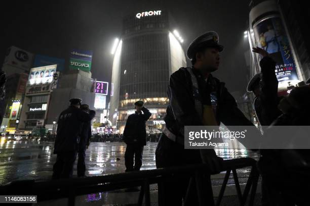 Police officers are seen standing in front of pedestrians at the famous Shibuya crossing on May 1 2019 in Tokyo Japan Japan's 85yearold Emperor...