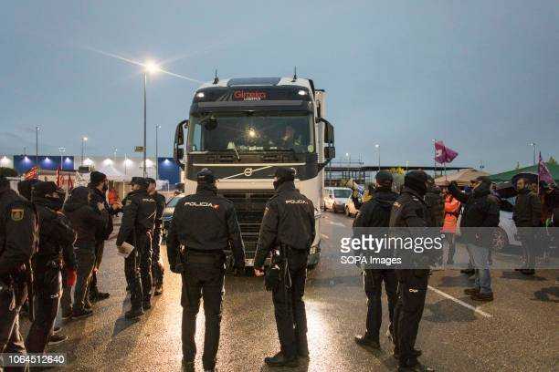 Police officers are seen surrounding a carrier at the entrance of the Amazon warehouse during the strike The workers of the largest Amazon warehouse...