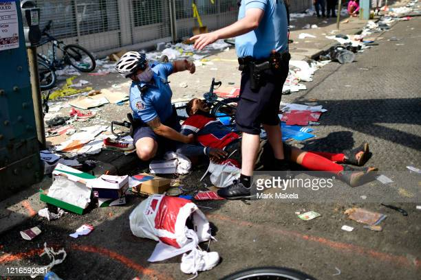 Police officers arrest a man during a protest of the death of George Floyd on May 31 2020 in Philadelphia Pennsylvania Protests have erupted all...