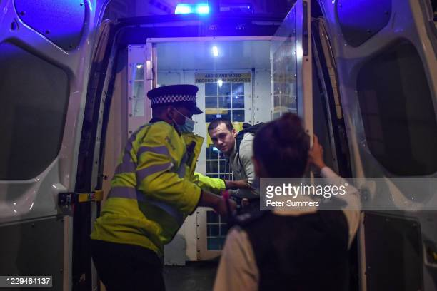 Police officers arrest a man in Soho on November 4, 2020 in London, England. Non-essential businesses, including pubs and restaurants, will be forced...