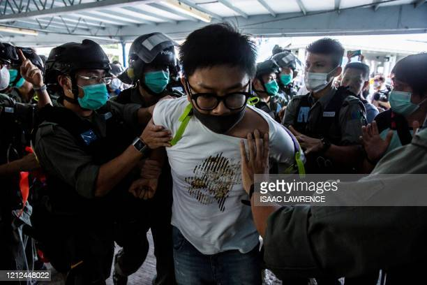 TOPSHOT Police officers arrest a prodemocracy demonstrator during a prodemocracy protest calling for the city's independence in Hong Kong on May 10...