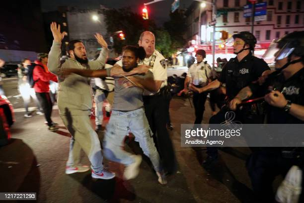 Police officers arrest a protestor continued to flout curfew restrictions was in effect from 8 p.m. Tuesday and expected to last until 5 a.m. Eastern...