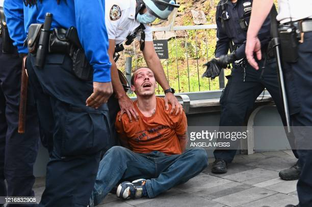 """Police officers arrest a protestor during a """"Black Lives Matter"""" demonstration over the death of George Floyd by a Minneapolis police officer, on..."""