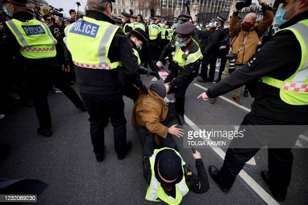 Police officers arrest a protestor during a 'Kill The Bill' protest against the Government's Police, Crime, Sentencing and Courts Bill, in central...