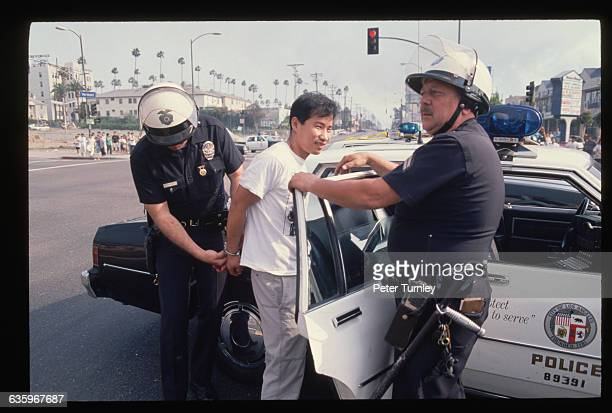 LA police officers arrest a young man during the Los Angeles Riots of 1992