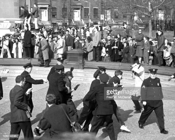 Police officers arrest demonstrators in Washington Square Park during a march April 9 1961 The march was held in protest of the parks commissoner's...