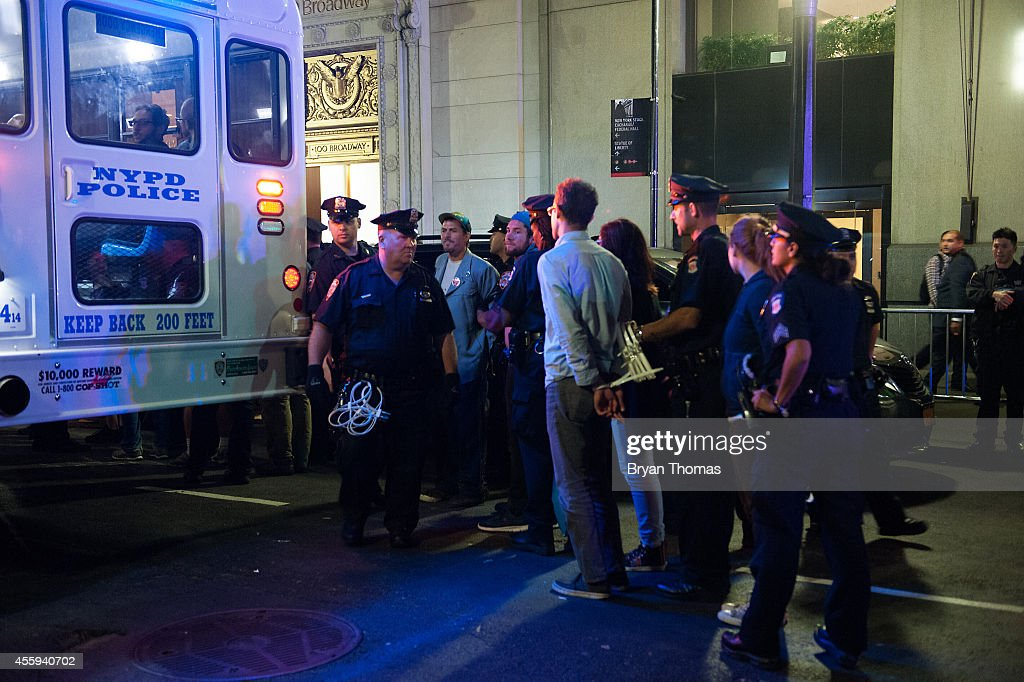 Police officers arrest demonstrators who refused to move from Broadway following the Flood Wall Street protest on September 22, 2014 in New York City. The Flood Wall Street protest came on the heels of the climate change march on September 21 that attracted over 300,000 protestors.