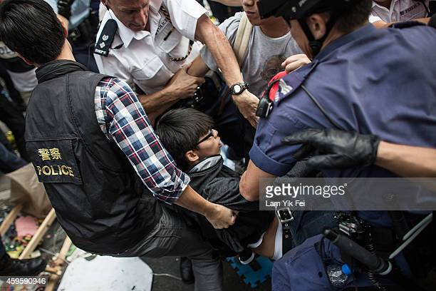 Police officers arrest Joshua Wong, student leader, in the Mong Kok district on November 26, 2014 in Hong Kong. The Mong Kok protest site is...