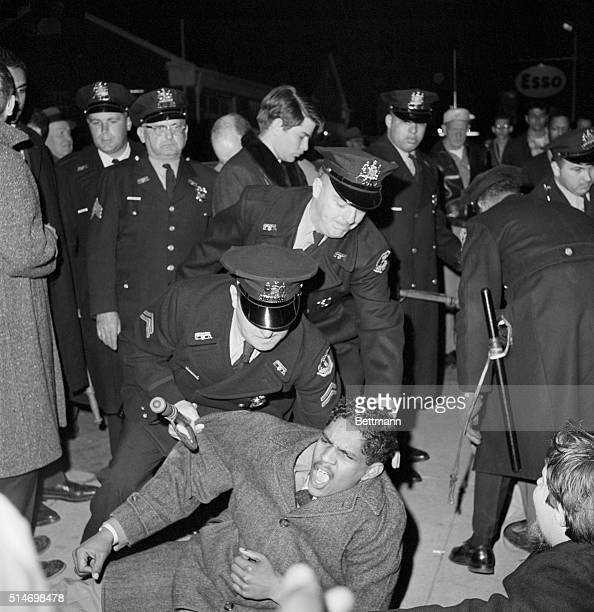 Police officers arrest Morgan State College student Ken Brown during a sit-in at an Annapolis restaurant.