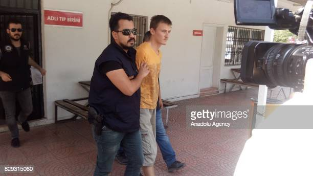 Police officers arrest Russian national over alleged plans to crash a drone into a US military flight in Adana Turkey on August 10 2017 Renat Bakiev...