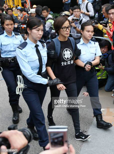 Police officers arrest singer and actress Denise Ho Wan-see during police removed barricades and tore down tents at protest site in Admiralty. 11DEC14