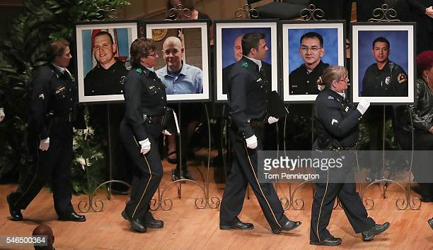Police officers arrive at an interfaith memorial service honoring five slain police officers at the Morton H Meyerson Symphony Center on July 12 2016...
