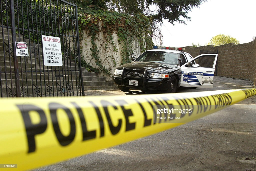 Police officers arrive at record producer Phil Spector's home on February 4, 2003 in Alhambra, California. Spector was arrested on February 3, 2003 for the murder of actress Lana Clarkson, 40, at his 33-room mock castle, Pyrenes Castle.