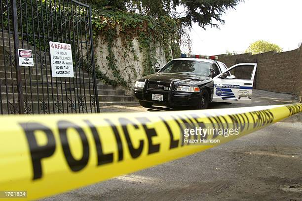 Police officers arrive at record producer Phil Spector's home on February 4 2003 in Alhambra California Spector was arrested on February 3 2003 for...