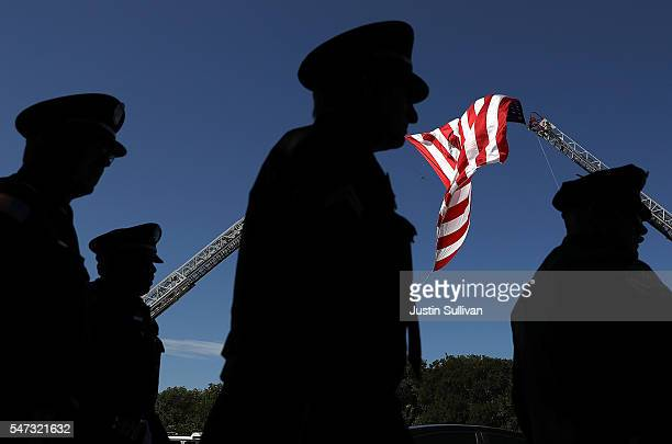 Police officers arrive at the funeral for slain Dallas police Sgt Michael Smith at The Watermark Church on July 14 2016 in Dallas Texas Dallas police...