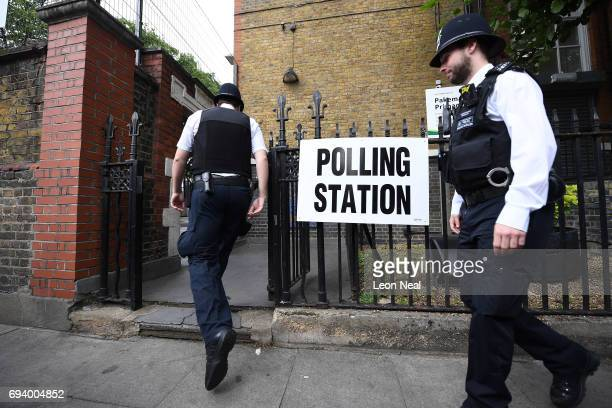 Police officers arrive at the polling station at Pakeman primary school on June 8 2017 in London United Kingdom Polling stations have opened as the...