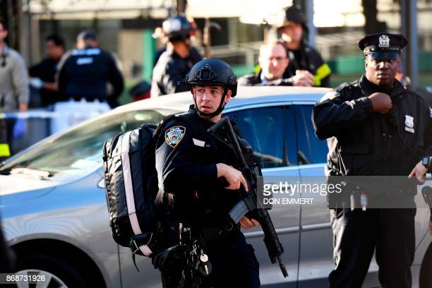 Police officers arrive at the scene following a shooting incident in New York on October 31 2017 Multiple people were hurt in downtown Manhattan US...