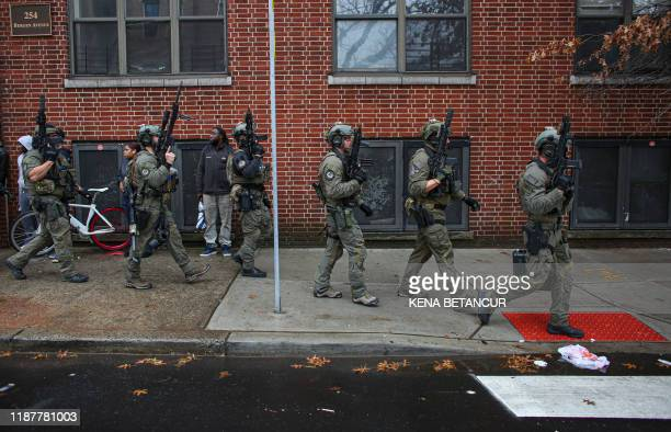 Police officers arrive at the scene of an active shooting in Jersey City New Jersey on December 10 2019 A shooting in a New York suburb not far from...