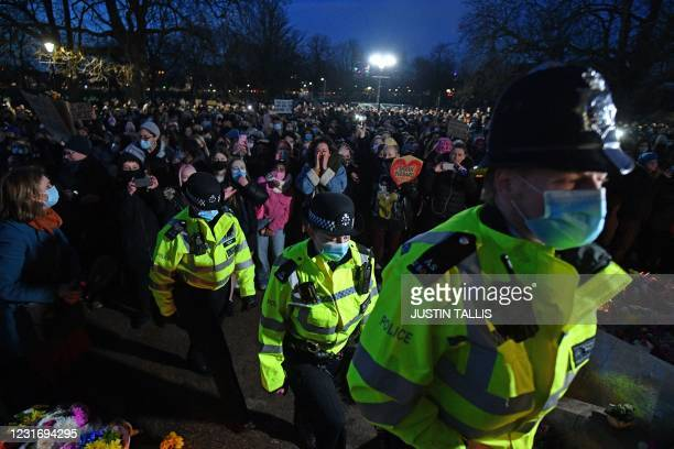 Police officers arrive to police a gathering at the band-stand where a planned vigil in honour of alleged murder victim Sarah Everard, which was...