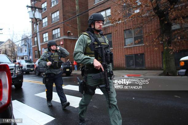 Police officers arrive to the scene where active shooting is happening in Jersey City on December 10 2019 One officer was shot when two gunmen with a...