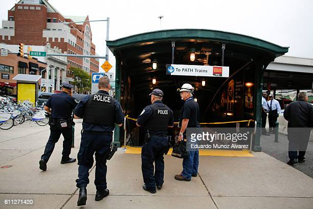 Police officers arrive to the train terminal after a New Jersey Transit train crashed into the platform at Hoboken Terminal during morning rush hour...