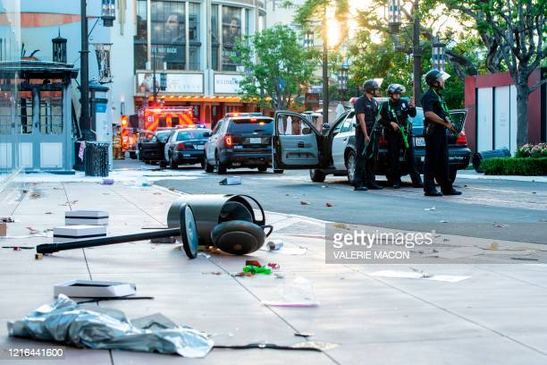 Police officers arrived after people looted and destroyed shops at the Grove shopping center in the Fairfax District of Los Angeles on May 30, 2020...