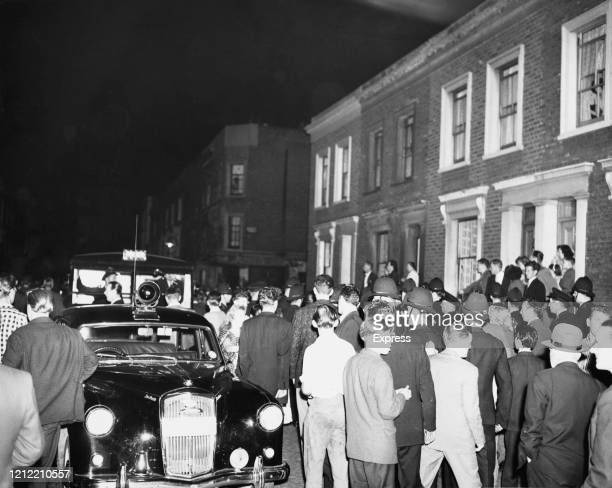 Police officers arriving on a car in Notting Hill during the Notting Hill Race Riots, London, UK, 1st September 1958.