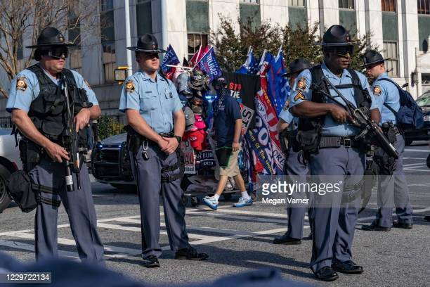 Police officers ask protestors to disperse as supporters of Donald Trump host a 'Stop the Steal' protest outside of the Georgia State Capital...