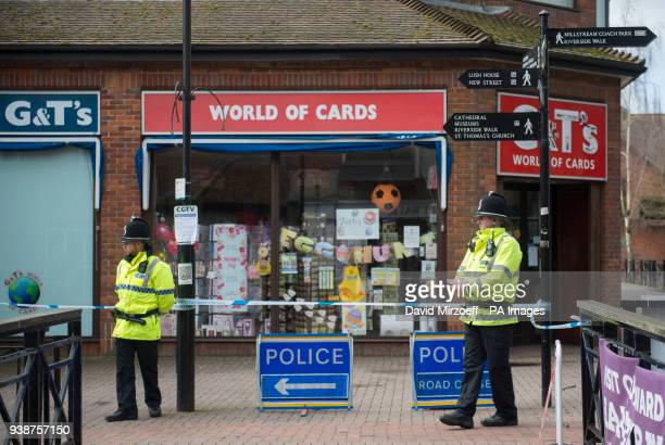 Police officers at a cordon near the Maltings in Salisbury in front of a card shop which remains closed still advertising Mother's Day cards in the...