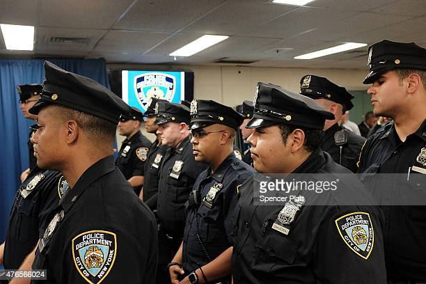 Police officers at the 44th Precinct in the Bronx stand at Roll Call on June 10 2015 in New York City In an effort to combat the rise in murders and...