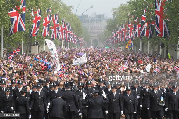 Police officers at the Mall as thousands of wellwishers from around the world have flocked to London to witness the Wedding of Prince William and...