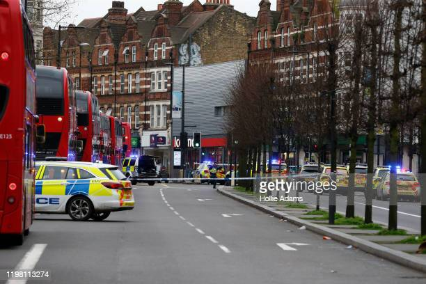 Police officers at the scene after a man was shot and killed by armed police on February 2 2020 in London England The Metropolitan police have said...