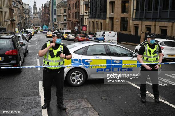 Police officers at the scene after there were initial reports of three people being killed in a central Glasgow hotel on June 26, 2020 in Glasgow,...
