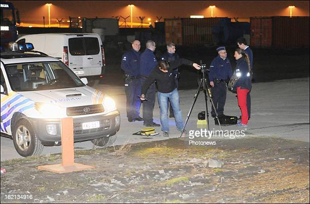 Police officers at the scene of the heist at Brussels Airport on February 18 2013 in Zaventem Belgium Using a van and car to break down the security...