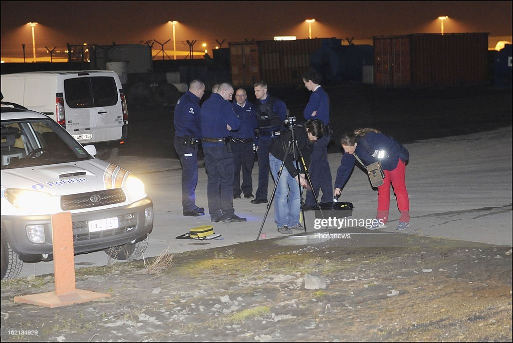 Police officers at the scene of the heist at Brussels Airport on February 18, 2013 in Zaventem, Belgium. Using a van and car to break down the security fence a gang of robbers stole diamonds estimated to be worth 50 Million Euros from a security van.